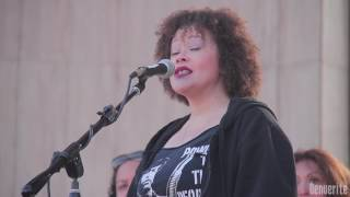 Suzi Q Smith reads a poem at the Women's March on Denver