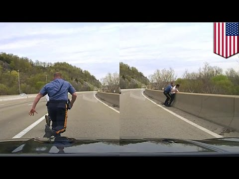 Dramatic footage shows cop stopping man from jumping off bridge in New Jersey - TomoNews