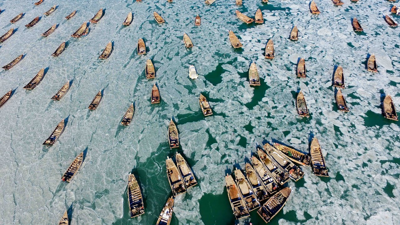 Freeze! Hundreds of fishing boats trapped in ice in NE ...