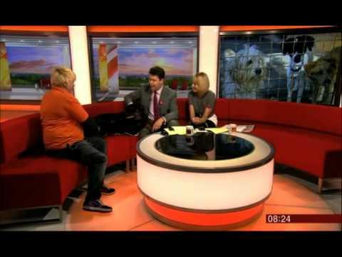 'Dangerous dog' cuddles up to Jon Kay on BBC Breakfast