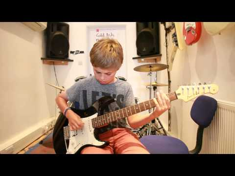 11 year old Sam plays Radio by The Blackout on guitar