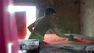 Hardworking block printing artist working at a textile workshop