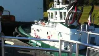 arrival of two tugboats pushing a large vessel through the ballard locks 08 15 2010