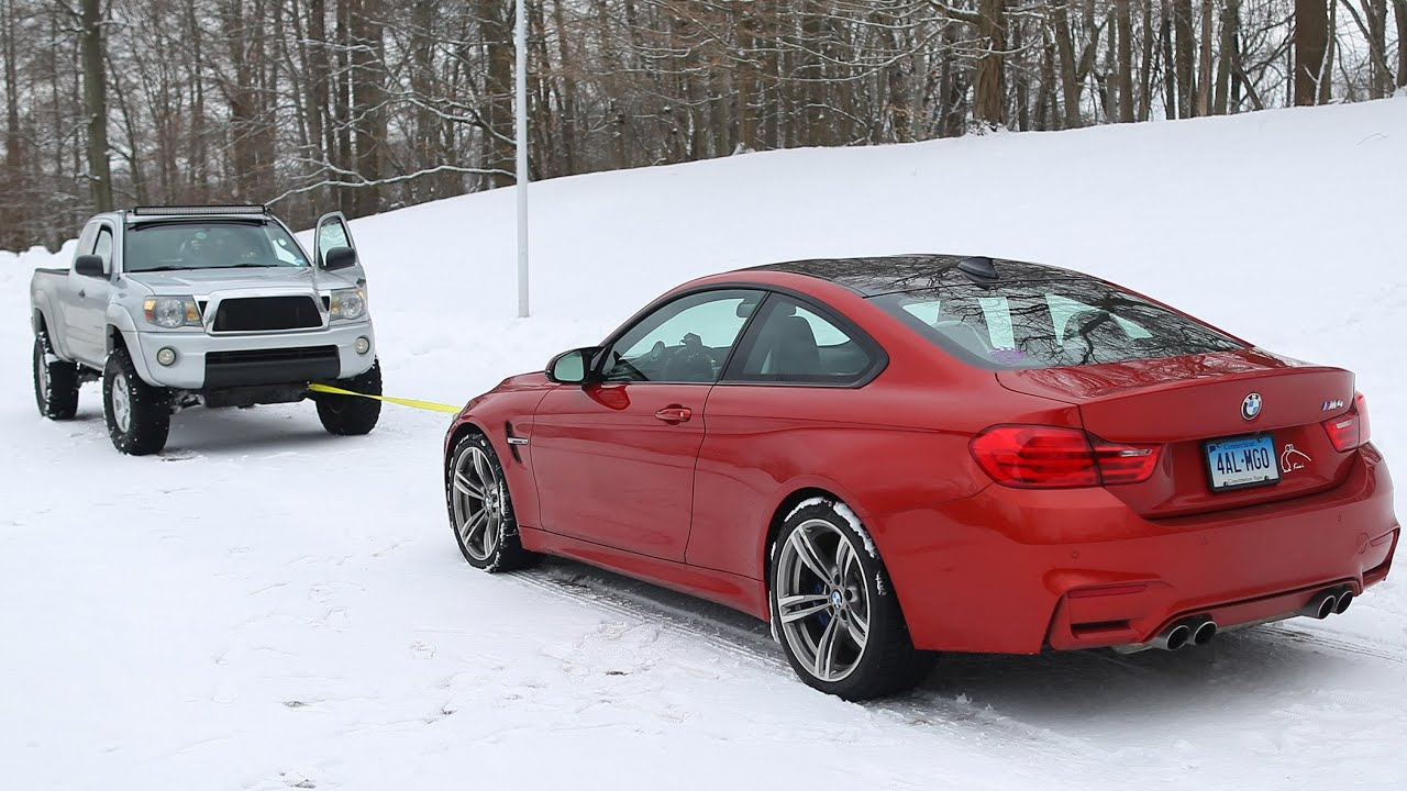 BMW M4 vs Toyota Tacoma Snow Tow  YouTube
