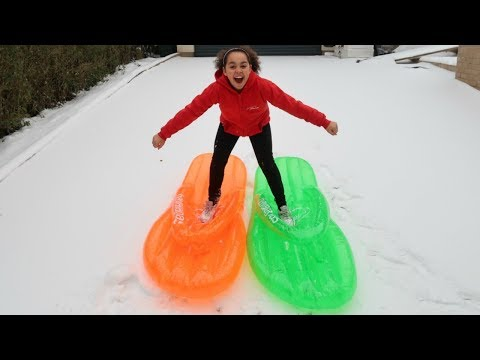 BEST SNOW DAY EVER!! Sledding On Inflatable Floaties |Toys AndMe