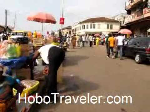 Walking with Backpack in Kumasi Ghana Bus Station