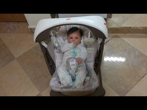 Cute Baby In Fisher-Price Deluxe Take-Along Swing And Seat