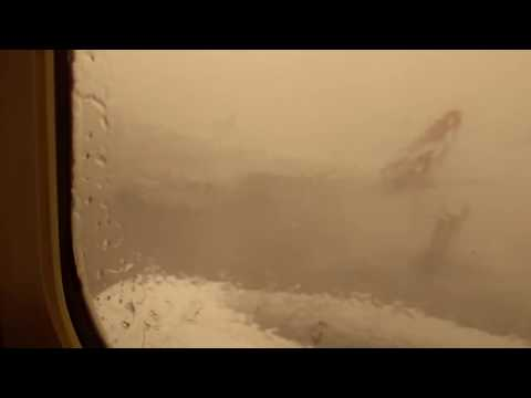 Airport stairs SLAM into parked plane during storm, Brisbane Airport 13 Nov 2016