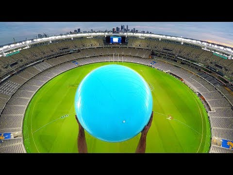 CATCHING EXERCISE BALLS with MAGNUS EFFECT from STADIUM ROOF