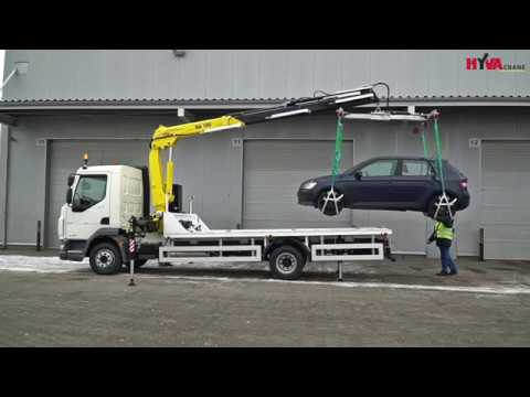 Recovery truck lifting car by crane - Hyva Crane Car Recovery Application