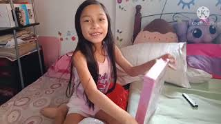 Unboxing her shopee delivery.. Unicorn notebook with pen