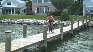 mini bike jumping into the water