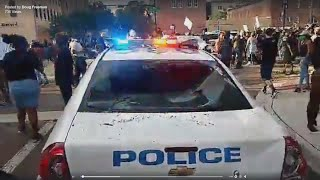 WATCH: Video shows protester destroying JSO vehicle in downtown Jacksonville