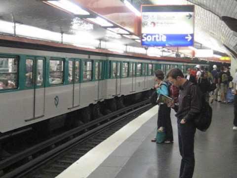 France: Paris Metro train of rubber tyred MP73 stock at Denfert Rocherau station (Line 6 / Ligne 6)