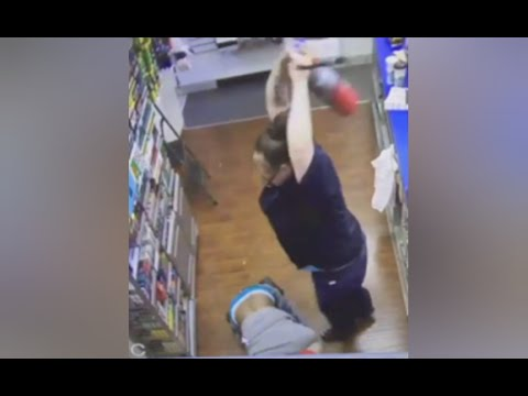 Woman Fights Off Robber With Fire Extinguisher [CAUGHT ON TAPE]
