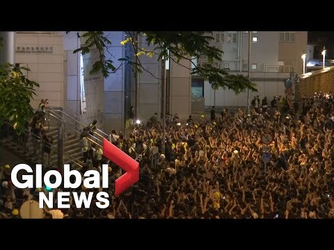 Anti-extradition protesters in Hong Kong rally outside police headquarters