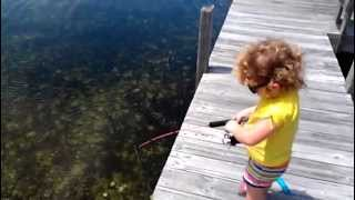 2 year old girl catches her first fish