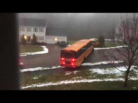 School bus slides down icy road during morning pickup