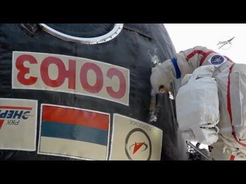 Watch a Spacewalking Cosmonaut Take a Knife to Soyuz Capsule