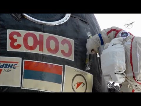Watch a Spacewalking Cosmonaut Take a Knife to Soyuz Capsule