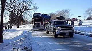 Chevy Silverado DMAX pulling a jackknifed Semi-Trailer hauling cars out of a ditch.