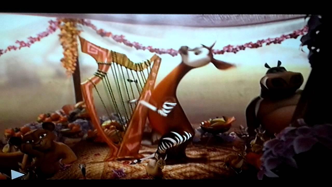 Female Okpai plays the harp
