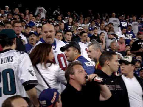 crazy giants fan fighting eagles fans at giants stadium