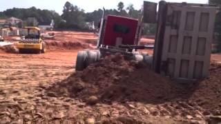 Dump bed falls off truck