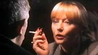 Karin Baal with red nails smokes a cigarette