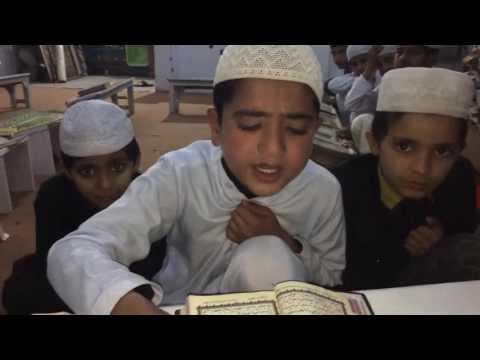 how to teach quran online:a child reciting quran