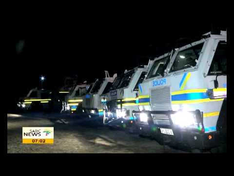 Police raid mine hostels ahead of the Marikana massacre commemorations