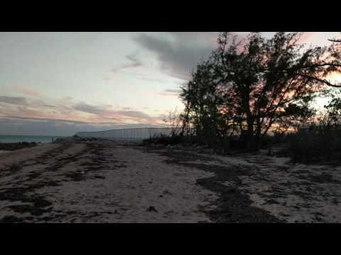 Beach walking sunset in Nassau Bahamas