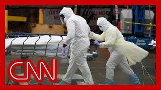 US coronavirus death toll surpasses 100,000