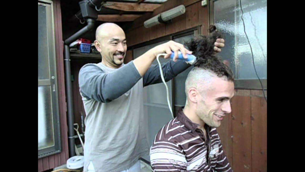 Woman getting their head shaved