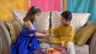 Raksha Bandhan - Sister ties rakhi on her younger brothers wrist