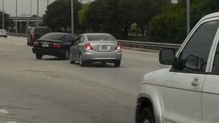 Miami driver runs red light, almost causes accident