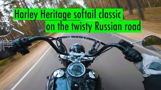 Riding Harley Davidson Heritage Softail Classic 107 on the twisty road in Russia