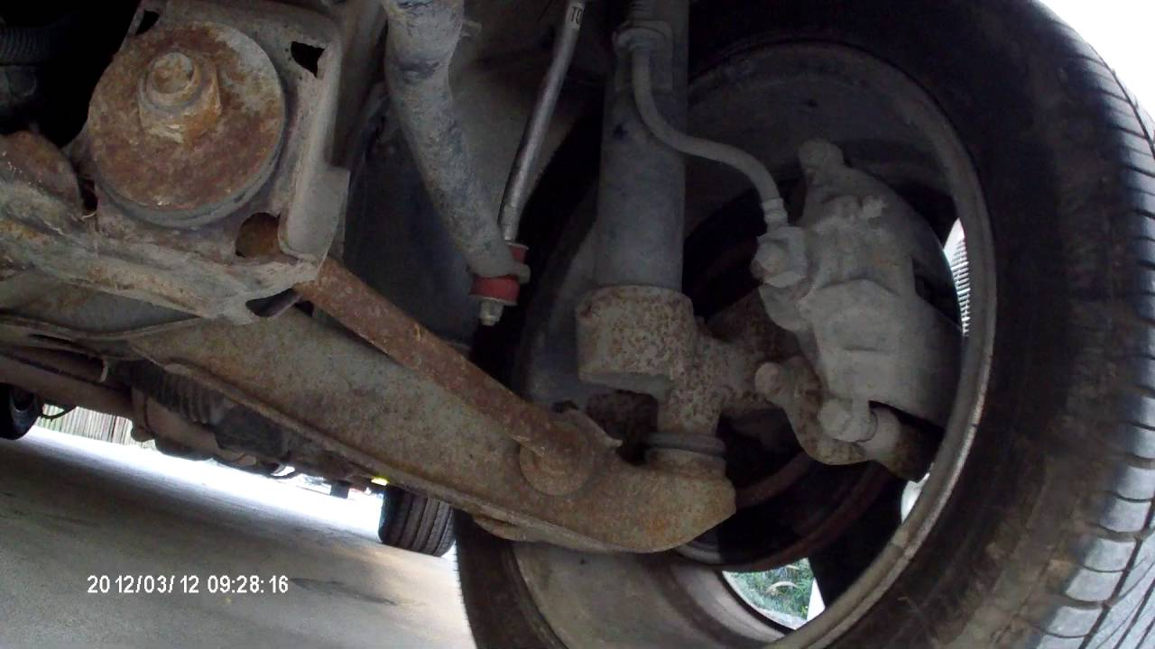 VN Commodore front suspension knock  YouTube