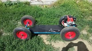 Skateboard на больших колёсах и двигателем от триммера.
