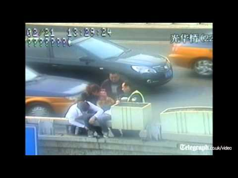 Chinese police officer saves bridge jumper