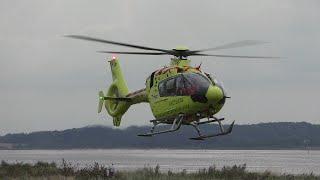 Medical helicopter Eurocopter EC135 landing and take off in Holbaek