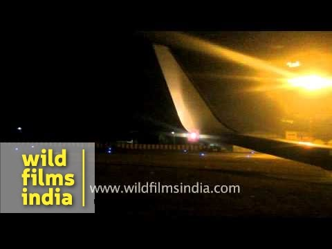 Air India plane approaches and lands at Ahmedabad airport