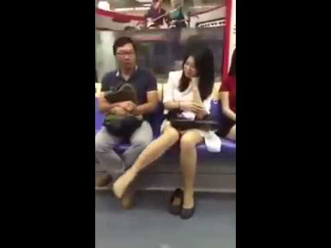 Lady desperately looking for men on Singapore MRT