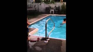Mom in pool looking sexy in her bikini