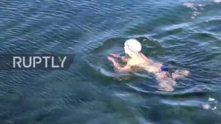 Russia Mothers and children plunge into near-frozen Lake Baikal