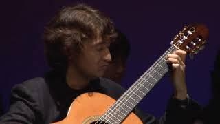 Shiro Otake, a New York based guitar player performs the final part of 'Bachianas Yupanquianas,' during his recital in Tokyo, with Kyoko Kagawa (poem reading ...
