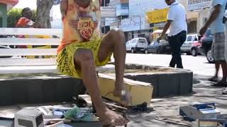 Man without arms by birth makes toy cars for his living