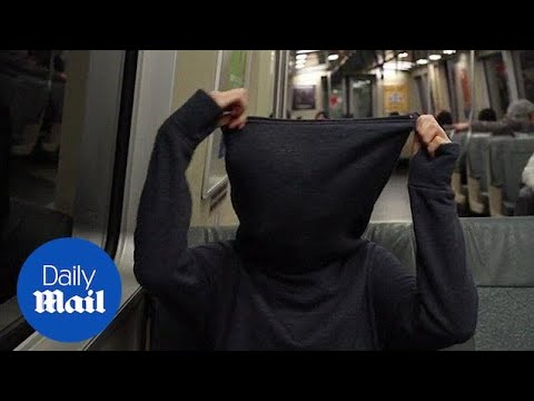 Anti-social sweater has zipped cowl to ensure privacy - Daily Mail