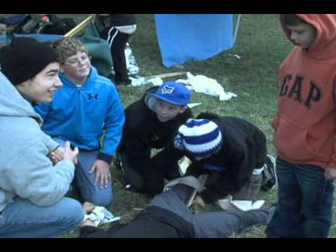 Boy Scouts Practicing First Aid