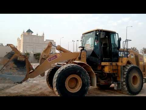 Earth moving by emil at almabani general contractor grounds with cat966h loader